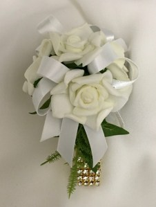 White roses, antique white ribbon, gold diamante wristband.