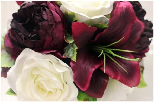 Detail close up of stunning wine burgundy lilies, wine peonies and white roses.