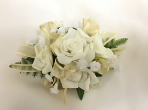 White roses with gold organza ribbon and added baby's breath.