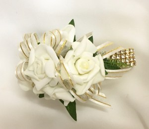 White roses, ivory with gold thread ribbon, gold diamante wristband.