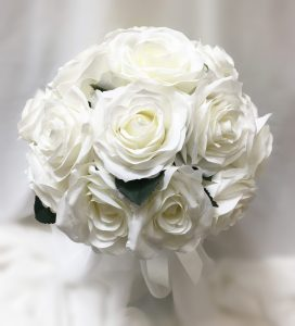Formal bridal posy using open white roses.