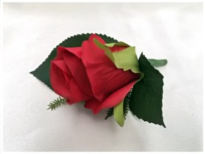 Bright red rose buttonhole