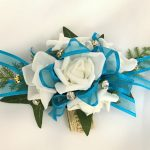White roses, turquoise ribbon, gold diamante`s added.