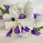 Orchid corsage with purple organza ribbon.