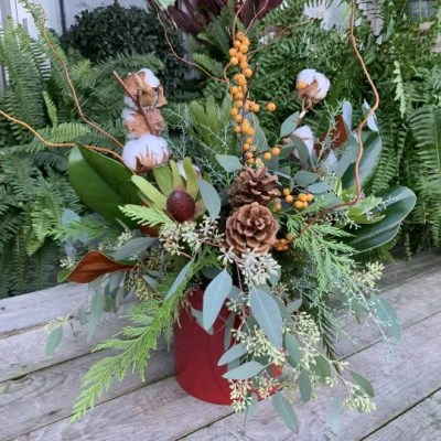 winter arrangement with pinecone and leaves