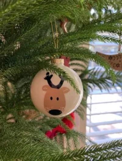 reindeer ornament in tree
