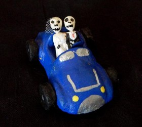 Skeleton bride and groom in a roadster