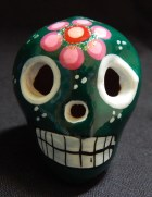 Dark green decorated skull (front view)