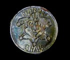 Coin with embossed jester symbol
