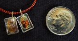 "Worn for protection and blessings. Dedicated to various saints denoted by different colors-Global-Roman Catholic-Orange cord/Metal/Plastic- 1/4"" each"