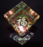 Cube with Chinese symbol on a base