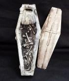 Open coffin with bones
