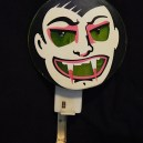 Vampire noisemaker (eyes and mouth glow when lever is pressed)