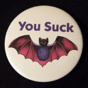 "Pin, ""You Suck"" with drawing of a bat"