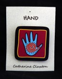 Pin with hand design with petroglyph design