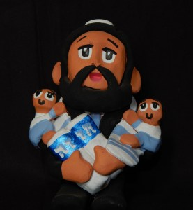 Satire on Pueblo Indian's story teller dolls-Created by a Mexican artist who discovered he may be descended from Crypto Jews