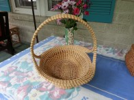 A dear friend who knew of my interest in the sweetgrass baskets of Low Country South Carolina, spied the basket on the left at a yard sale in Alexandria, Virginia, in 2002. She got the impression that a young couple were selling some of their wedding gifts. She bought this basket for $10. It's a double loop fruit basket that would have easily cost the giver a couple of hundred dollars. The history of tourism and sweetgrass baskets is long and complicated. The research of folklorists has helped make this a revered tradition that can sustain basket makers economically, put their work in fine art museums, and enrich understanding of this nation's complex race relations history through material culture.