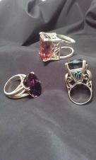 Three rings worn on stage in many acts. The large stones are green African amythyst, purple amythyst, and bright orange topaz.