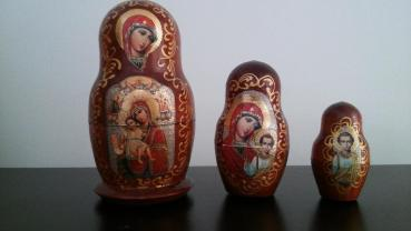 "​​This version of a Russian matryoshka nesting doll was purchased in Moscow, when I traveled there for a presentation in 2010. The innermost doll is a Christ child, appropriately nestled within the body of the larger dolls with the Virgin Mary on them. The larger two dolls have different icons of the Virgin on them. As I was shopping in a market, browsing various matryoshka dolls (including one with the 4 Beatles, one with various Russian and U.S. leaders, and one, which I gave to my sister, which had versions of Michael Jackson on each doll), the man who owned the stall heard me coughing. He urged me to buy this doll, since, he told me, ""She is good for [cough, cough],"" and patted his chest."