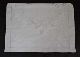 """Italian embroidered pajama-carrier.Cotton needlework, intaglio stitch, floral and butterfly design. Measures 19"""" by 14"""". Estimated to have been made in the early twentieth century. Photo by Dante Goldstein Ruberto."""