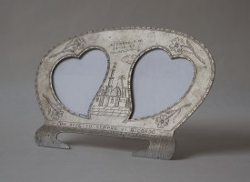 """Italian prisoner of war picture frame, with heart-shaped openings and stand. Metal engraved. Measures 7.5"""" by 4.5"""". Dated October 14, 1943. Photo by Dante Goldstein Ruberto."""