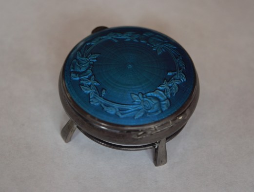 Engraved ring box. Silver, blue enamel, lined in red silk. Signed: Lacloche Freres Paris Londres. Measures 4.5cm diameter by 2cm high. Dated September 5, 1915. Photo by Dante Goldstein Ruberto.