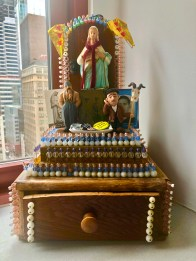 "Anonymous, Home Shrine, c. 1939, wood, plastic beads, nails, plaster statue 15"" by 10"" by 8"""