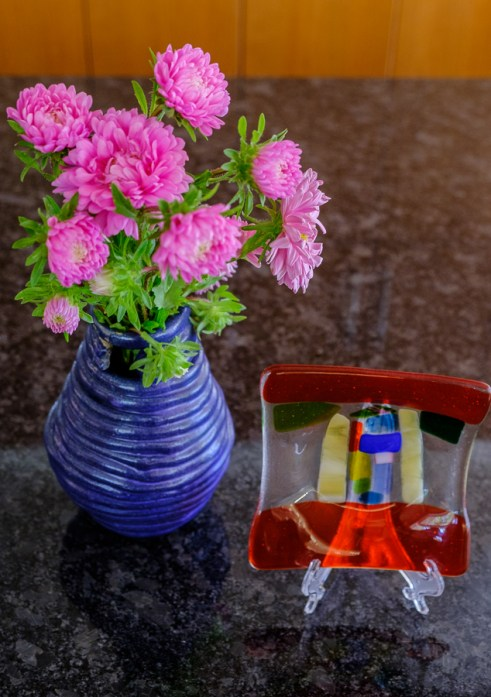 Pottery vase and kiln-formed glass made by my son, Rio, as a child.