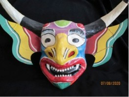 Papier Mache, 17 x 10 inches, molded in the shape of a face. Multi-colored, with a yellow nose and scary pointy teeth. The mask is quite beat up, but still frightening. He orchestrates the trouble the Shepherds will encounter. The favorite character to hate.
