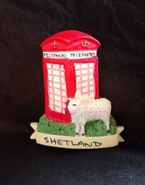 "Purchased in Lerwick Shetland 2016. Materials: plastic, magnet. Dimensions: 2"" x 2.5"" I was a summer intern at the Shetland Museum and Archives right out of college and while there learned a great deal about the unique local wool and sheep husbandry culture and traditions. When I saw this magnet on a recent visit I was drawn to it by the fact that despite the label there's nothing particularly Shelandic about the scene, and I would assume that there are many places in the UK where you can buy the exact same magnet. In many ways it is the antithesis of the extreme example of culturally located sheep souvenir you saw in the previous magnet with the pot of gold, hat, and ""Celtic"" font."