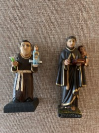 """The two San Antonios hold a tiny child that you can remove until the saint finds what you have lost…or a spouse! The one on the left is 4"""" wood carved by Julia R. Orta and the one on the right, made of clay, is 4.5"""" and comes from Portugal."""