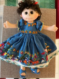 Also on my bookshelf, is a recent acquisition, a cloth doll from Michoacan that I named Chavelita. I got Chavelita at the Esperanza Peace and Justice Center Mercadito de Paz—an annual folk-art festival-- about 4 years ago. All handstitched and embroidered Chavelita is about 14 inches tall.