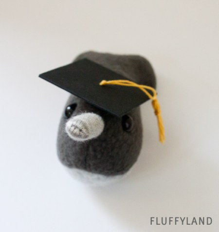 tiny narwhal with a graduation cap