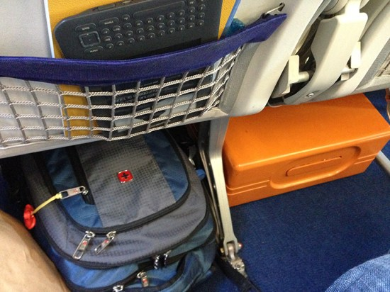 orange sewing machine in airplane