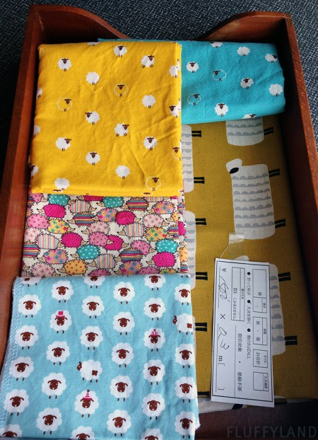 rainbow hedgehogs and lots of sheep - fabric from japan