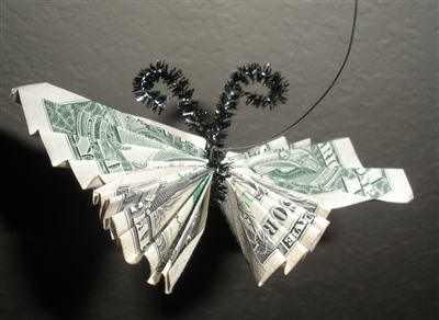 Origami butterfly fashioned from dollar bills