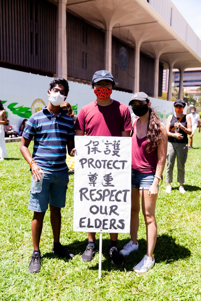 """Group of demonstrators with a sign saying """"Protect Respect Our Elders"""""""