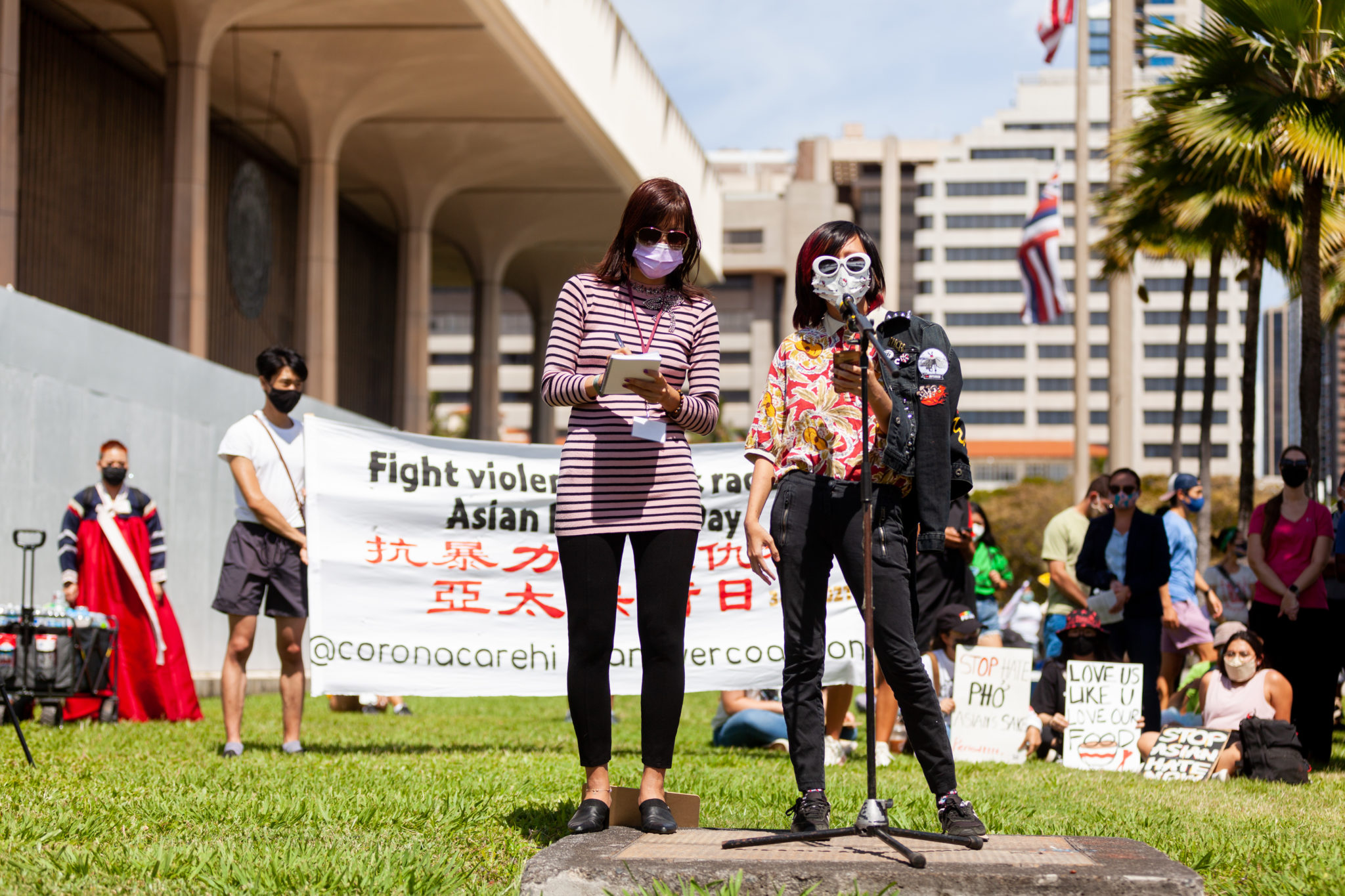 Two demonstrators at the Stop Asian Hate rally in Honolulu