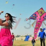 Couple enjoying kite flying - Kite Flying Show & Event - Artificial diamond studded lord Ganesh kite