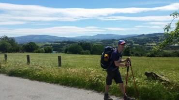 Matthew hikes with poles