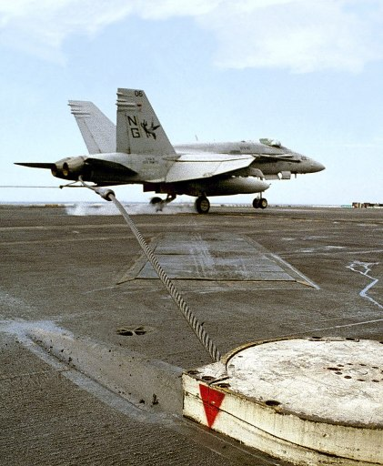 A VFA-147 FA-18C Hornet catching arresting wire on USS Nimitz (CVN-68) Photo: PH3 Christopher Mobley, U.S. Navy