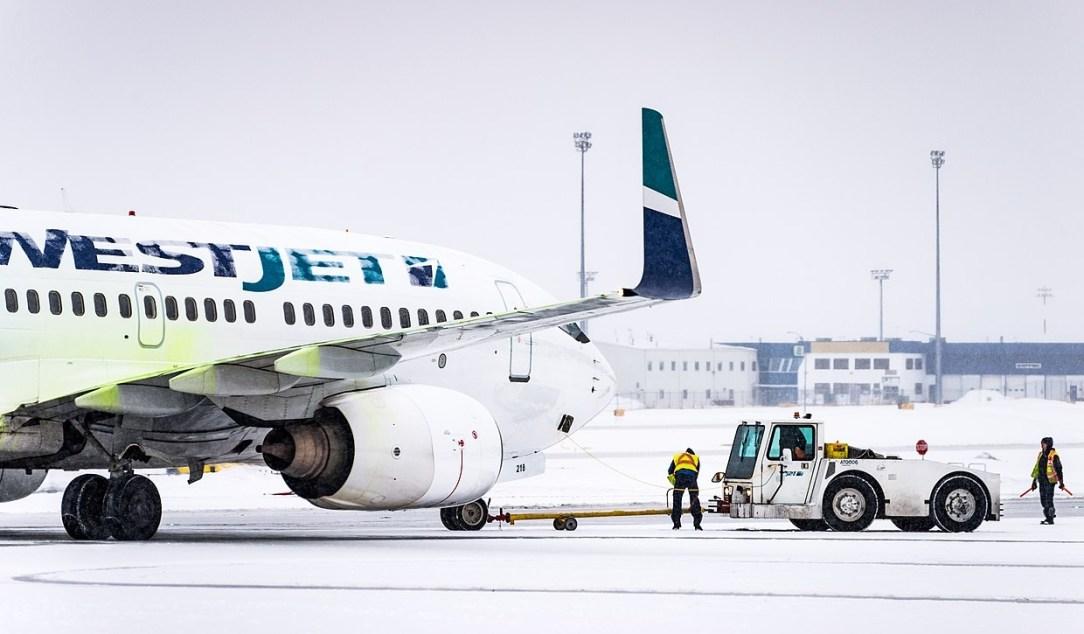 WestJet B737 skidded off runway at Halifax Airport