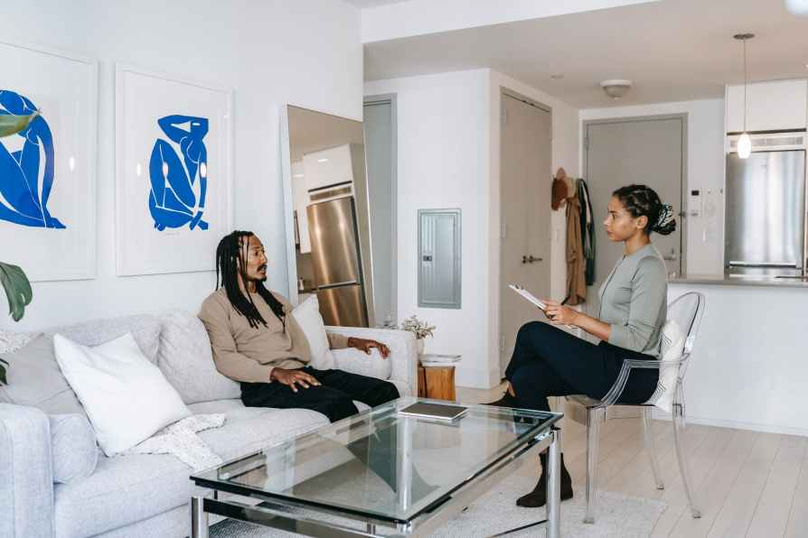 black man visiting female psychologist in modern office