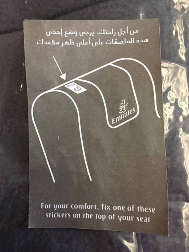 black seat sticker instructions on Emirates