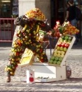 A street perfomer dressed head to toe in fruit in Plaza Mayor, Madrid, Spain