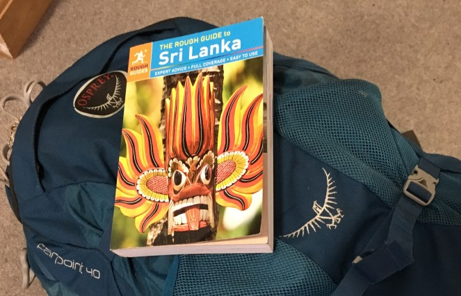 The Rough Guide to Sri Lanka book on top of a blue Osprey Farpoint 40 backpack