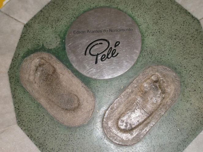 Pele's footprints in concrete with a signed bronze plaque on the walk of fame at the Maracana Stadium, Rio de Janeiro