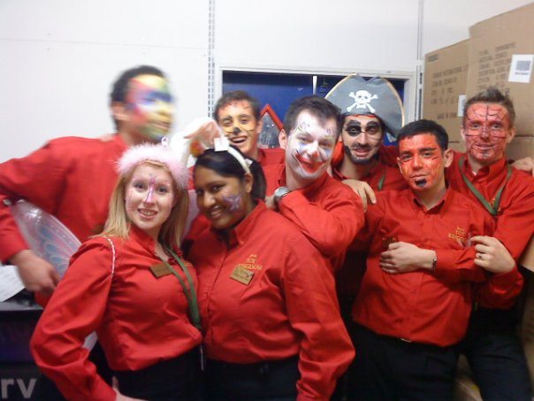 Rosie in her Harrods Toys red work shirts with some of her work friends, all with their faces painted