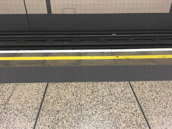 The yellow line on the edge of a tube platform