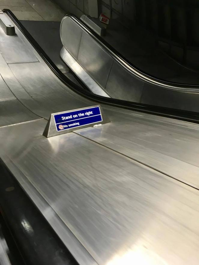 Escalator stand on the right sign
